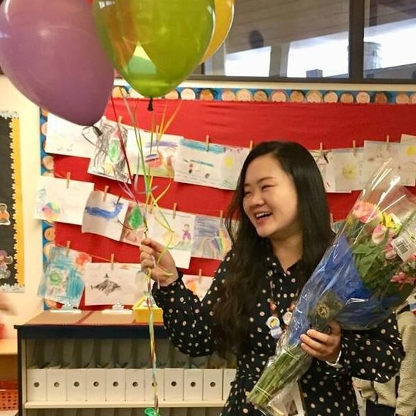 Ms. Lin with balloons and flowers
