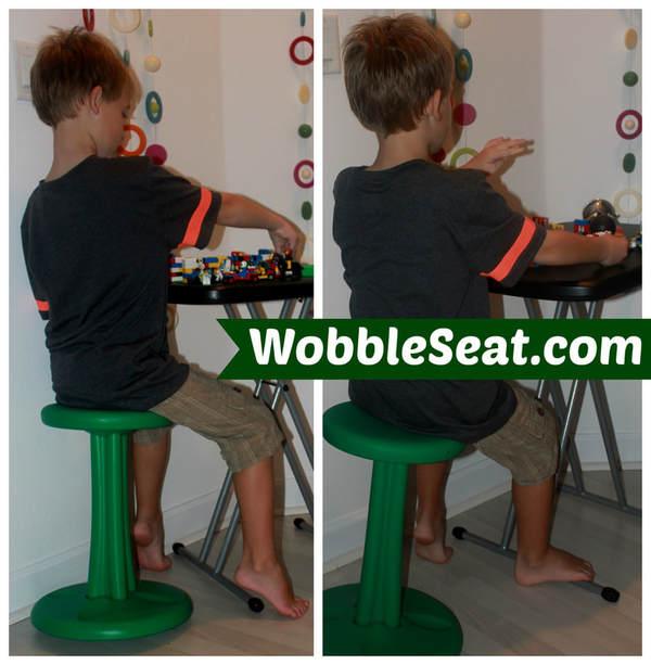 boy on wobble seat